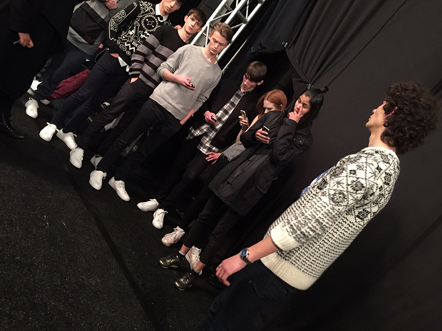 Models backstage getting ready to hit the runway